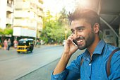 Handsome smiling man talking on mobile phone