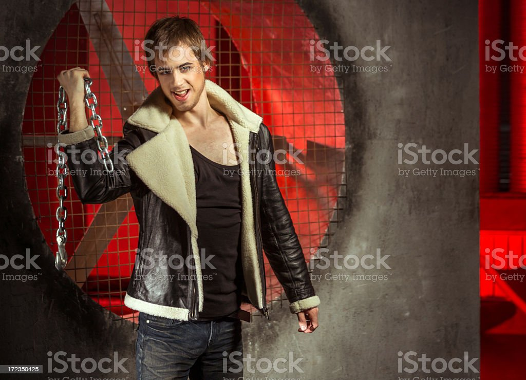 Handsome smiling man with metal chain royalty-free stock photo