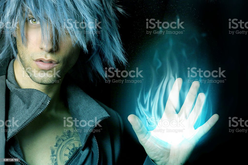 handsome sorcerer that creates a fireball stock photo