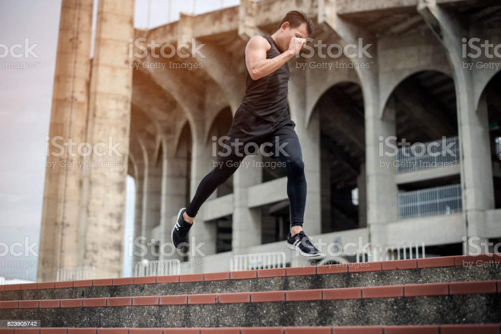 Handsome Sport man running at outdoor city stock photo