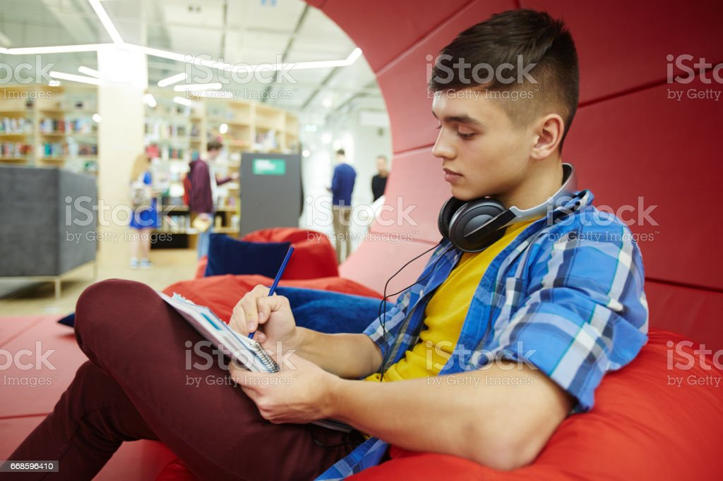 Handsome Student Working in Creative Space stock photo