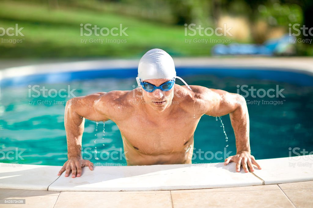 Handsome swimmer with cap and goggles stock photo
