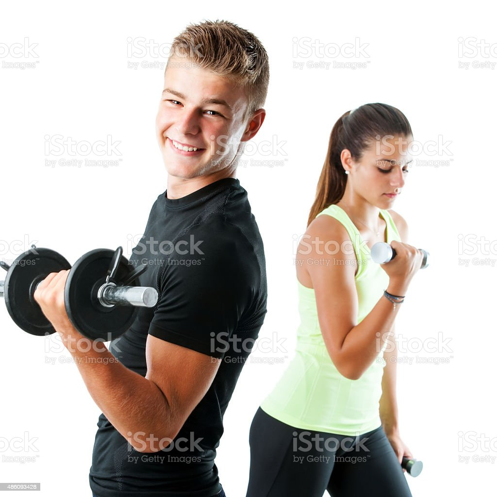 Handsome teen couple working out with weights. stock photo