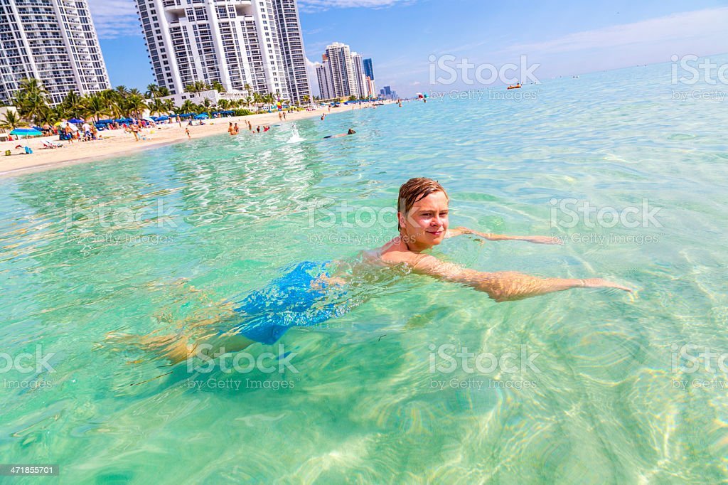 handsome teen has fun swimming in the ocean royalty-free stock photo