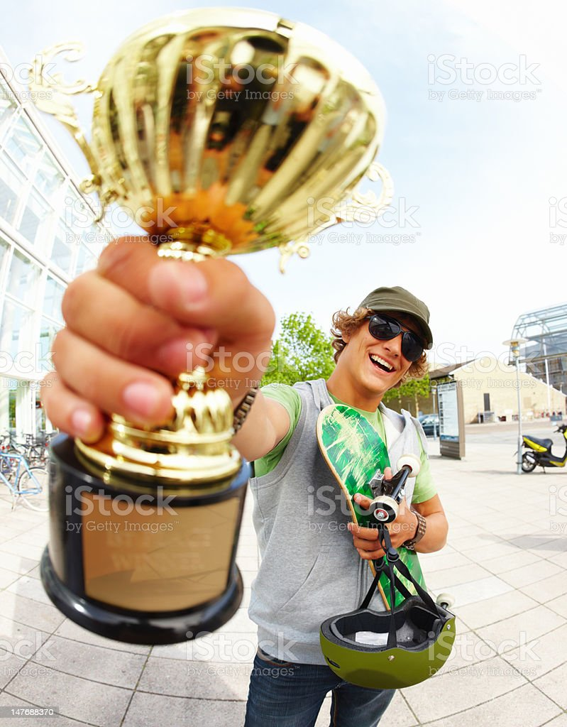 Handsome teenage boy holding cup on street royalty-free stock photo