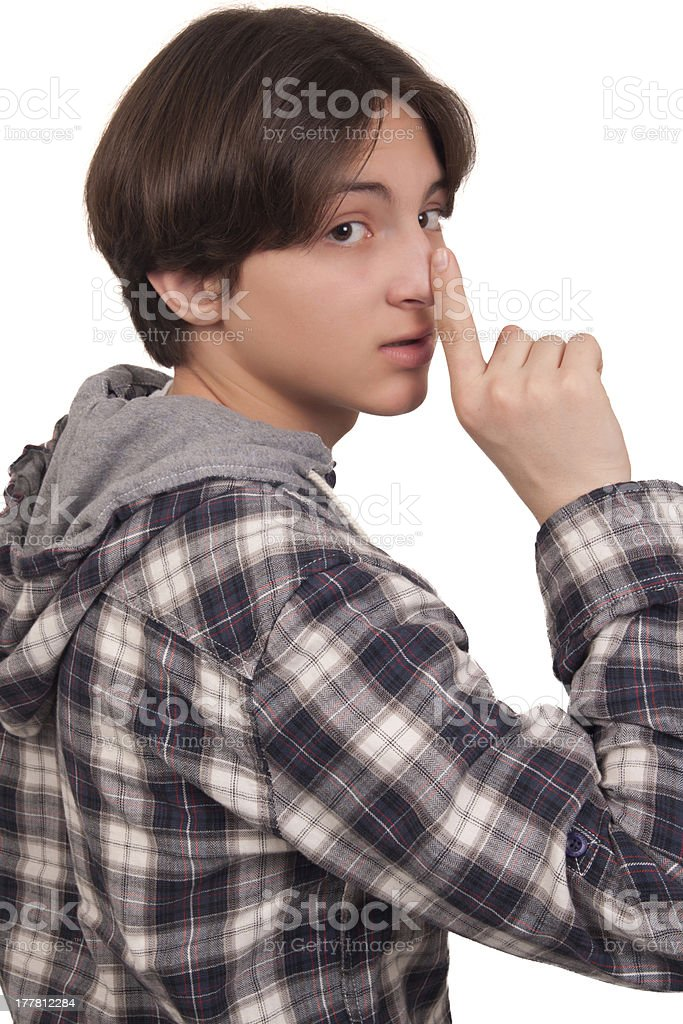 Handsome teenage boy showing silent sign stock photo