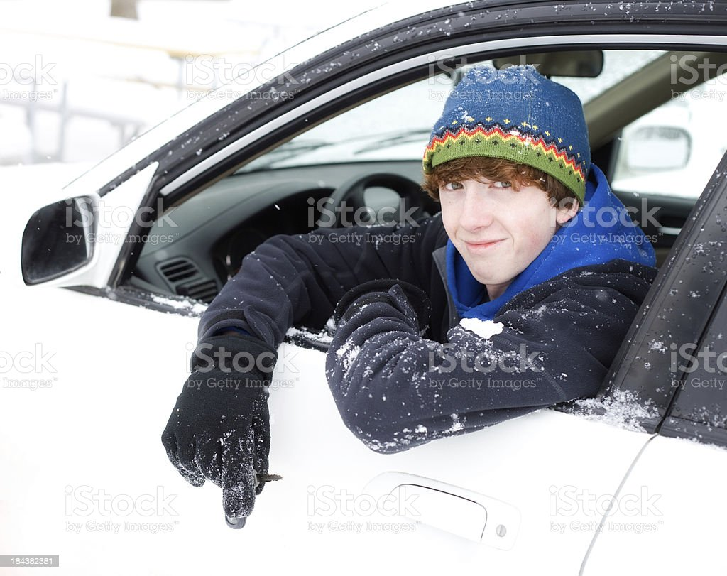 Handsome Teenager Driving in Snow stock photo