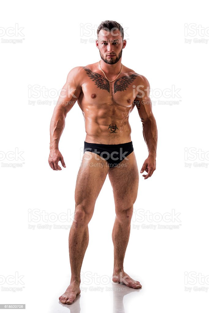 Handsome topless muscular man standing, isolated stock photo