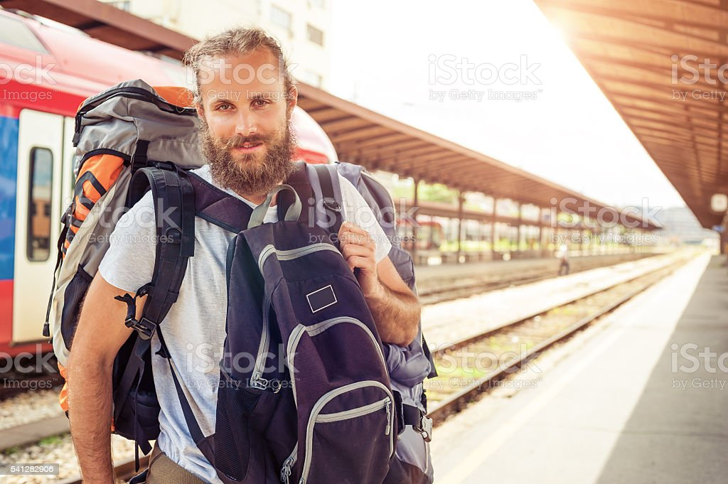 Handsome tourist traveler standing with huge luggage stock photo