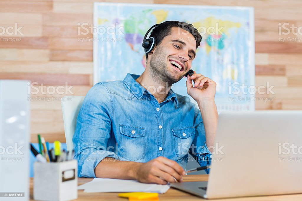Handsome travel agent speaking with customer stock photo