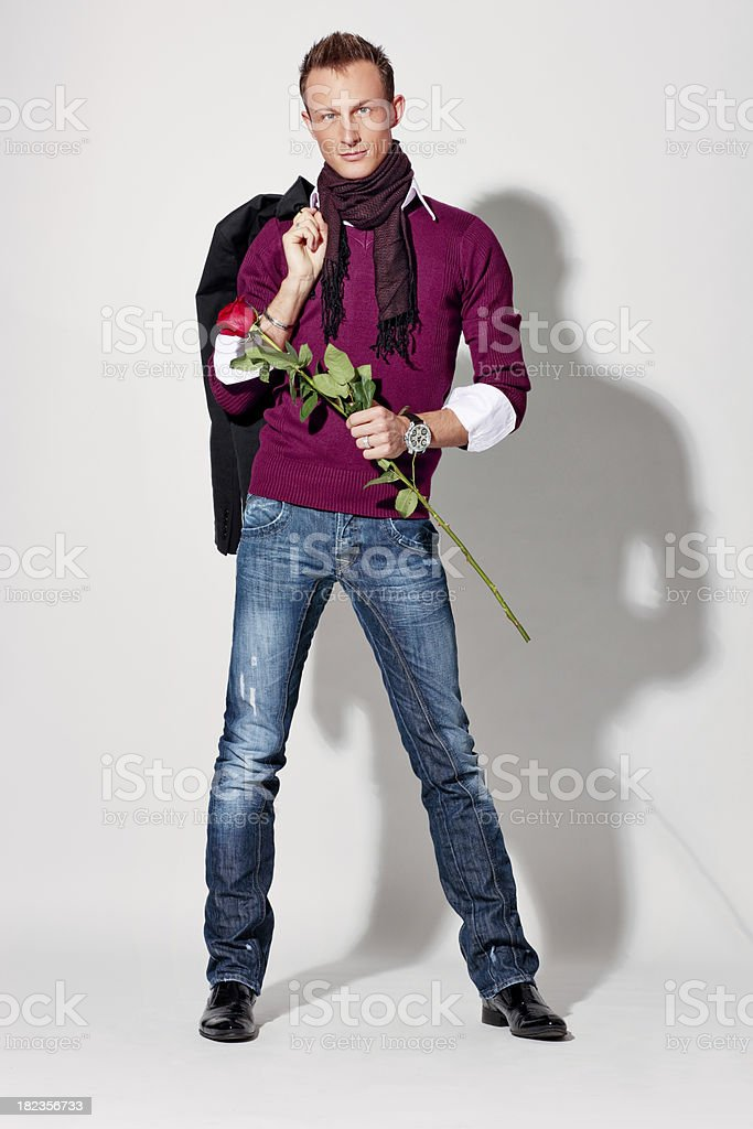 Handsome Well Dressed Young Man With Red Rose royalty-free stock photo