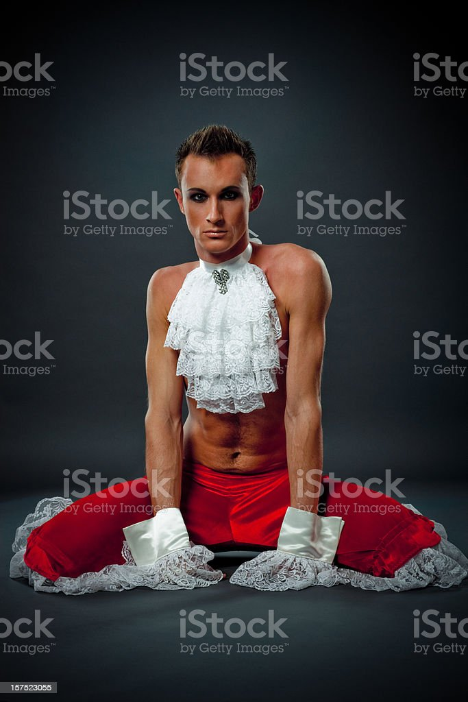 Handsome Young Actor in stage costume sitting on the floor stock photo
