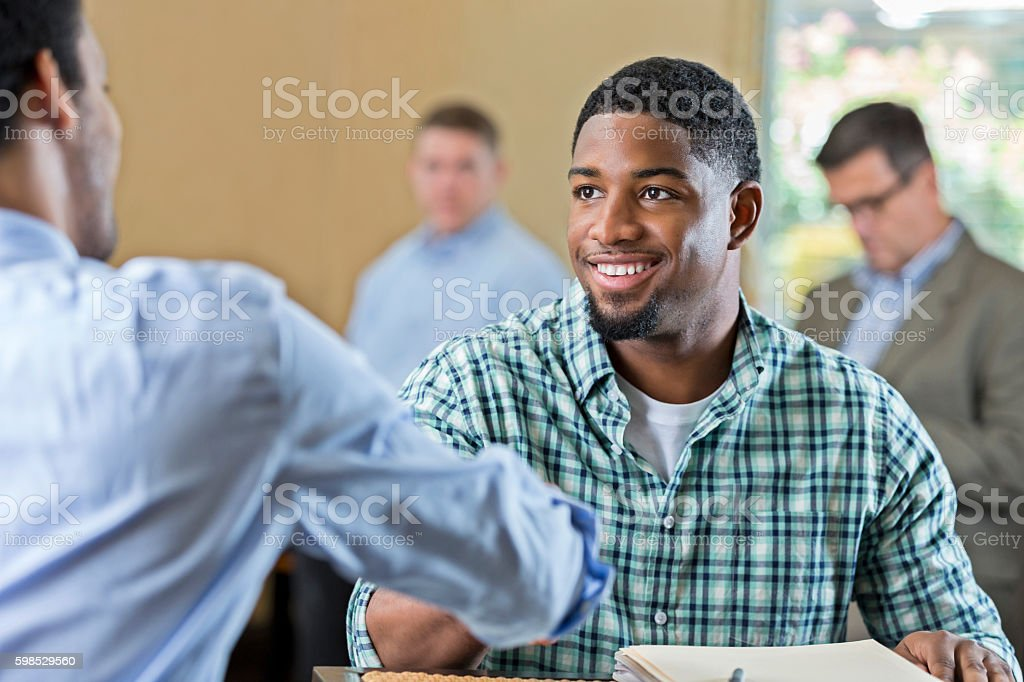 Handsome young African American man at job interview stock photo