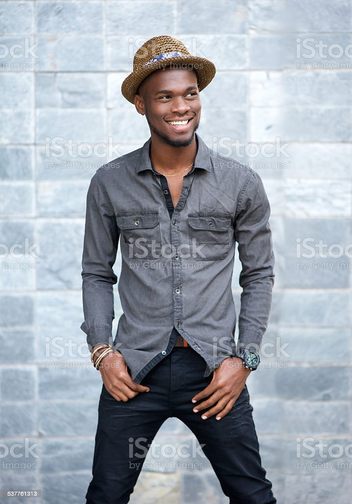 Handsome young african american man smiling with hat stock photo