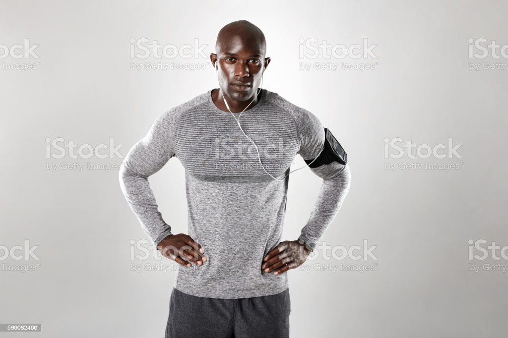 Handsome young african man listening to music stock photo