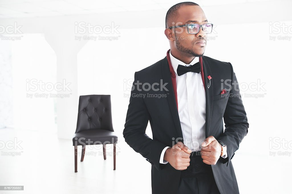 Handsome young african man posing on camera stock photo