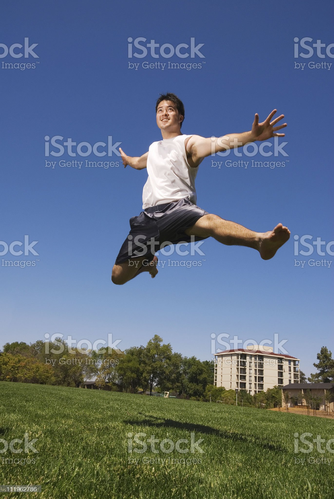 Handsome young bi racial man jumping outdoors royalty-free stock photo