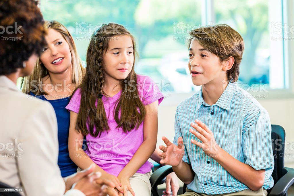 Handsome young boy telling a story stock photo