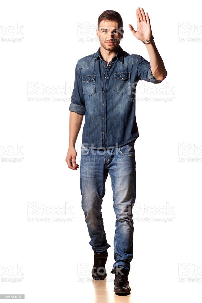 Handsome young boy waving hand on white background stock photo