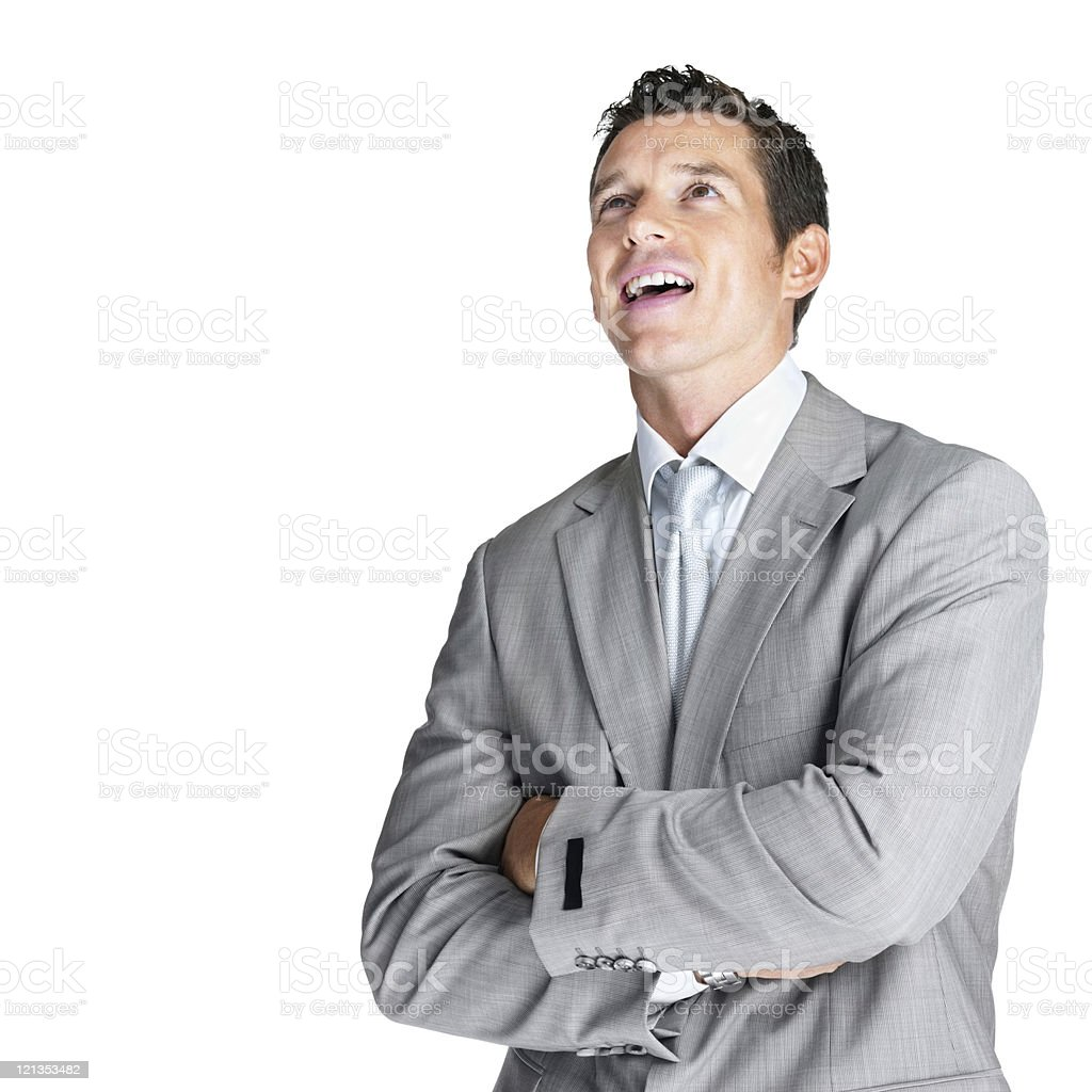 Handsome young business man looking upwards royalty-free stock photo