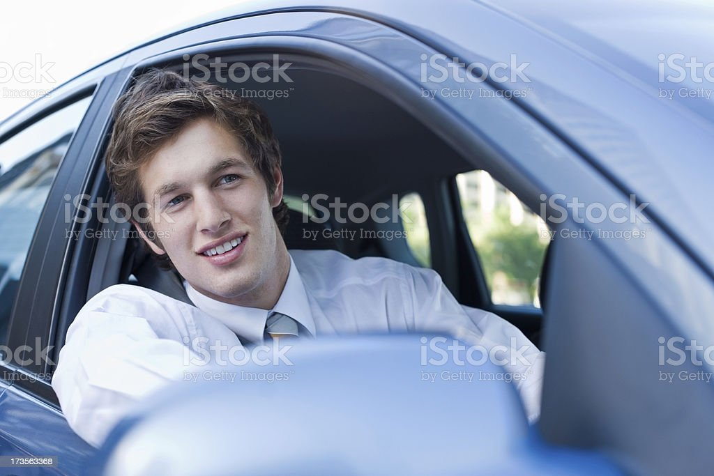 Handsome young businessman driving a car royalty-free stock photo