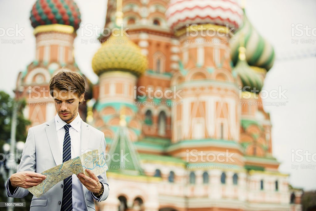 Handsome Young Businessman in Moscow holding street map stock photo