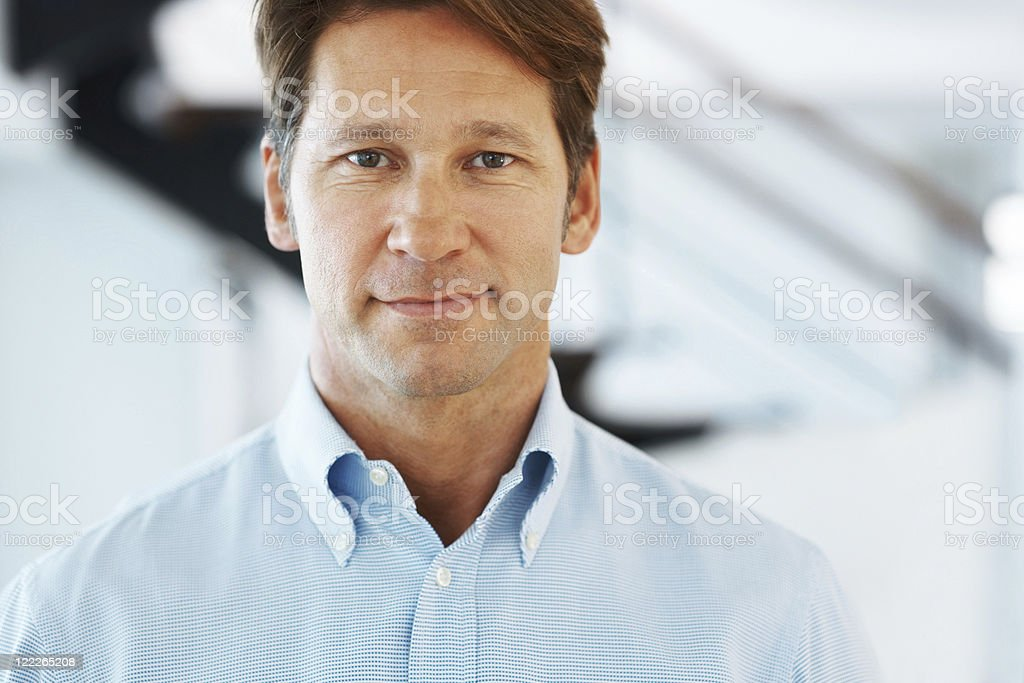 Handsome young businessman looking confident stock photo