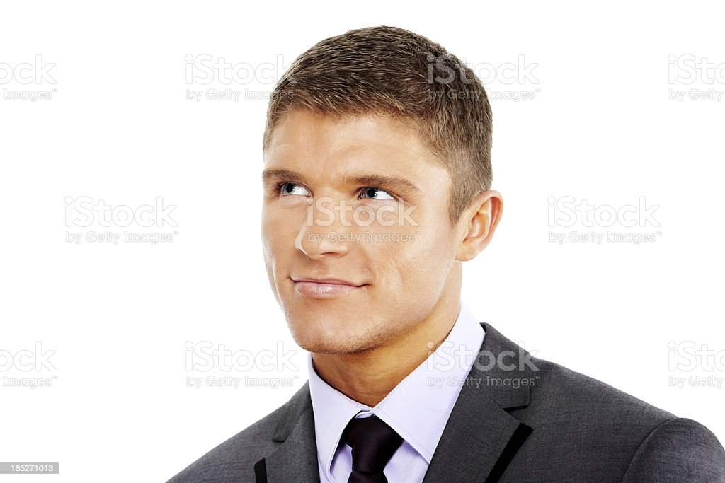 Handsome young businessman looking up at corner royalty-free stock photo