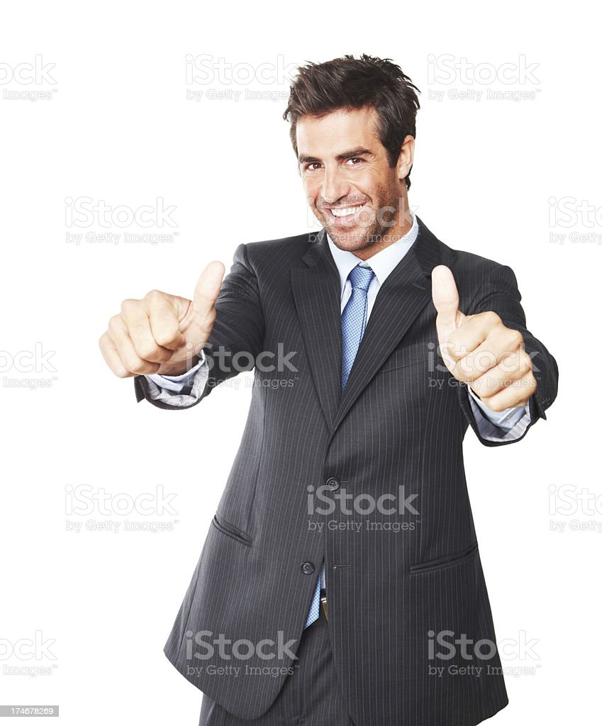 Handsome young businessman showing thumbs up royalty-free stock photo