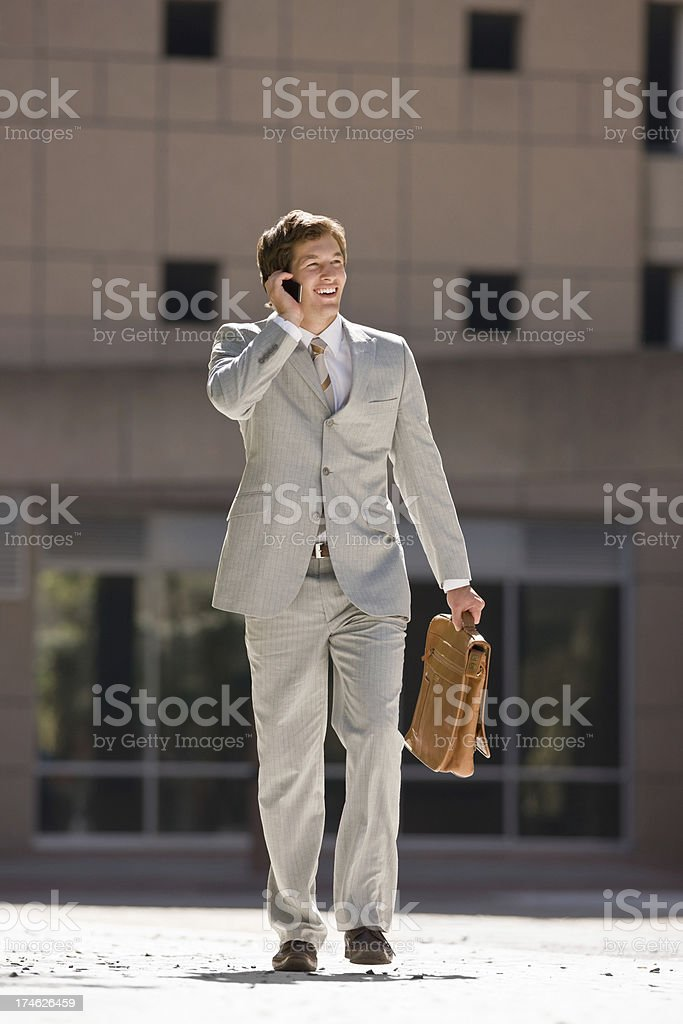 Handsome young businessman talking on mobile phone royalty-free stock photo