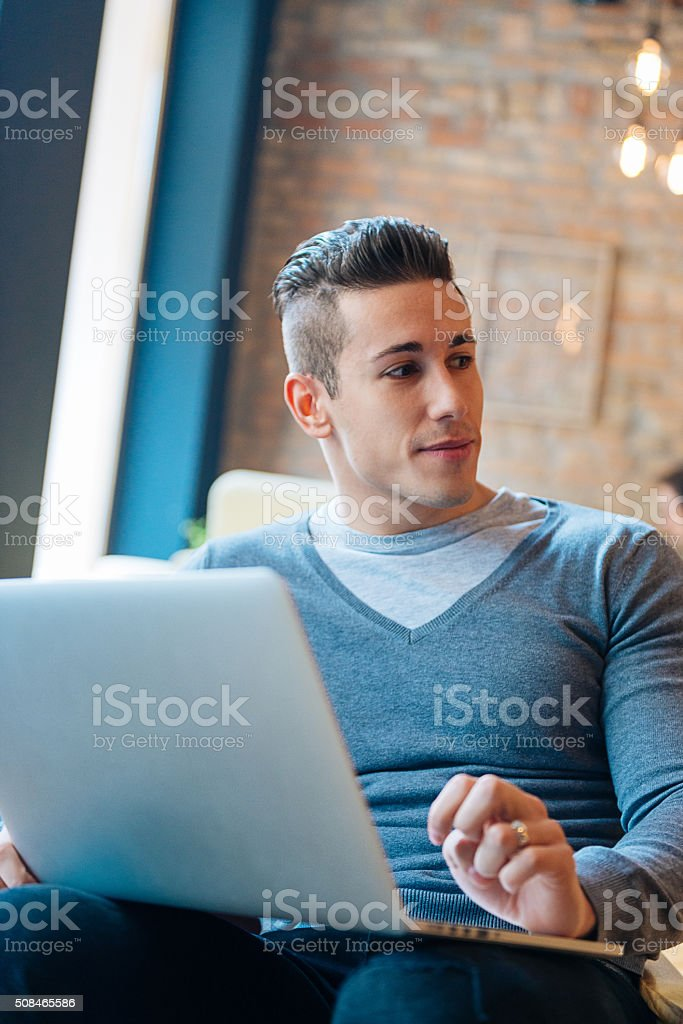 Handsome young businessman using notebook computer for start-up business stock photo