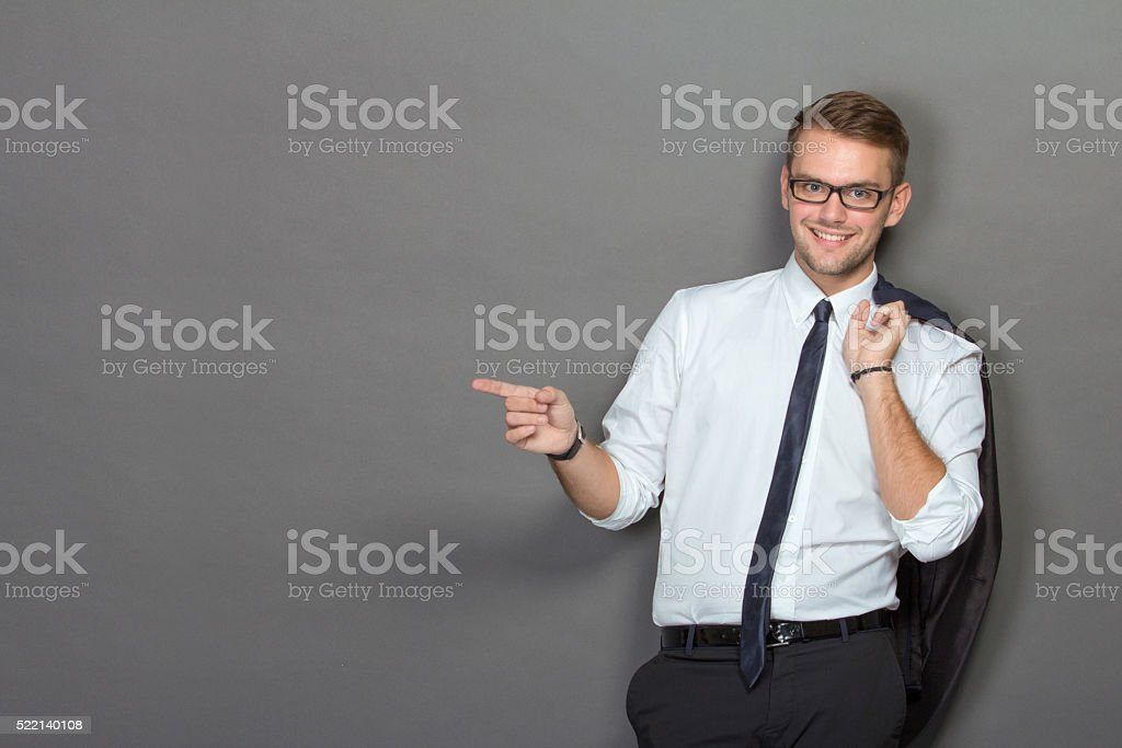 Handsome young businessman wearing glasses and smiling stock photo