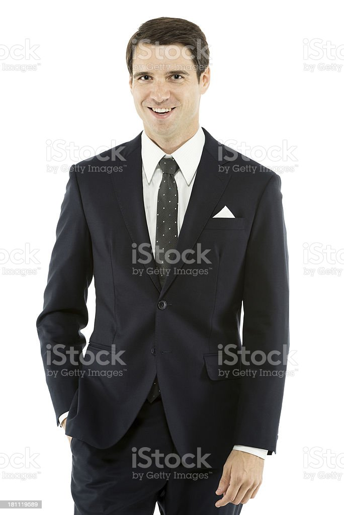 Handsome young businessman with hands in pocket stock photo