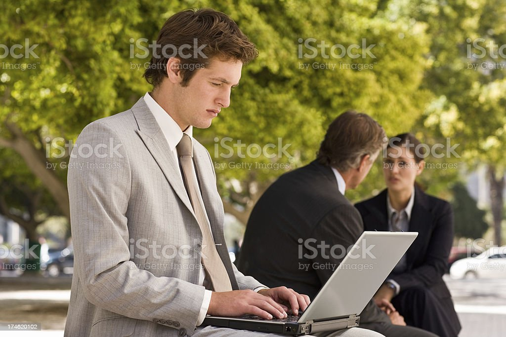 Handsome young businessman working on laptop royalty-free stock photo