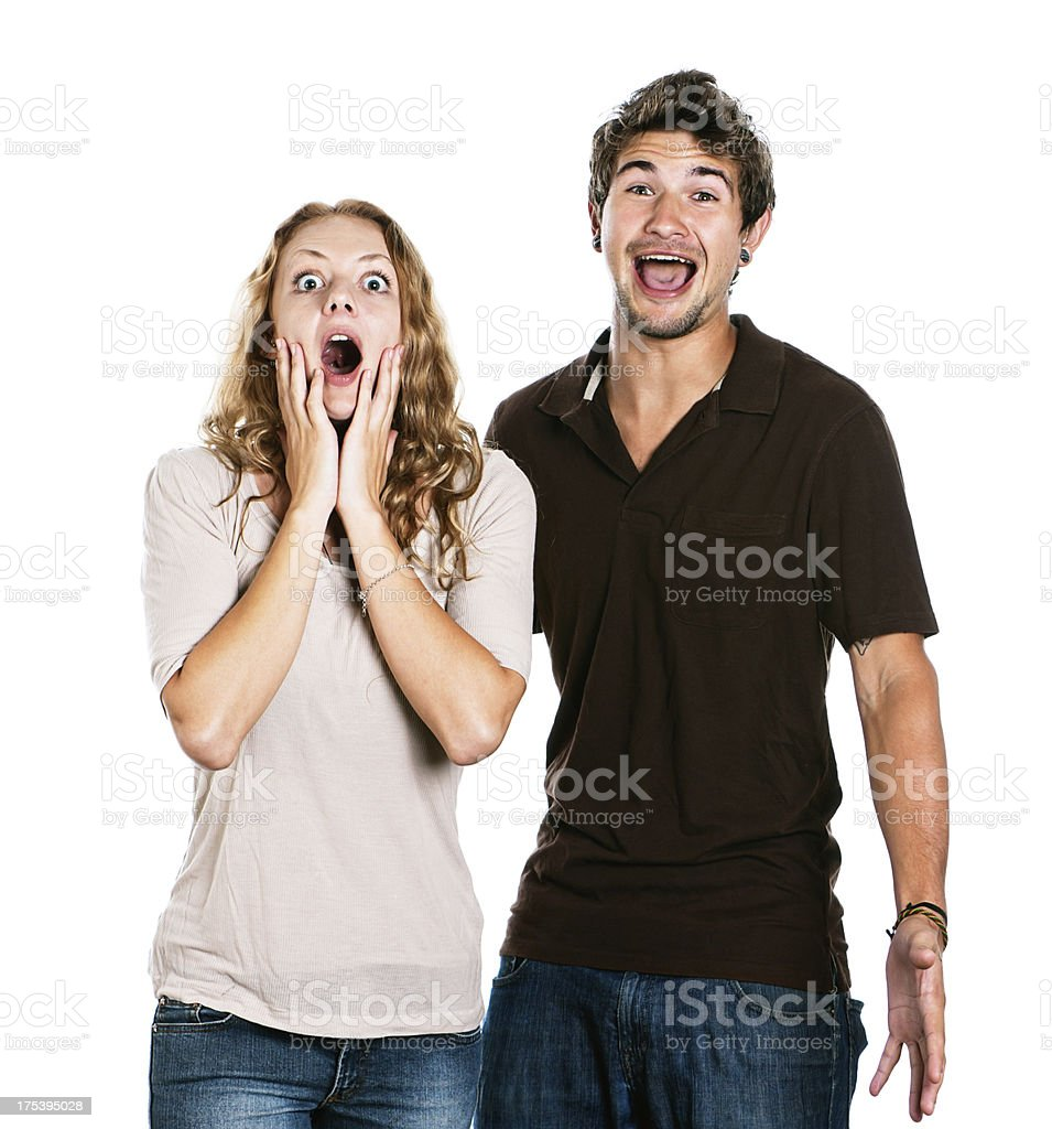 Handsome young couple are amazed and amused stock photo