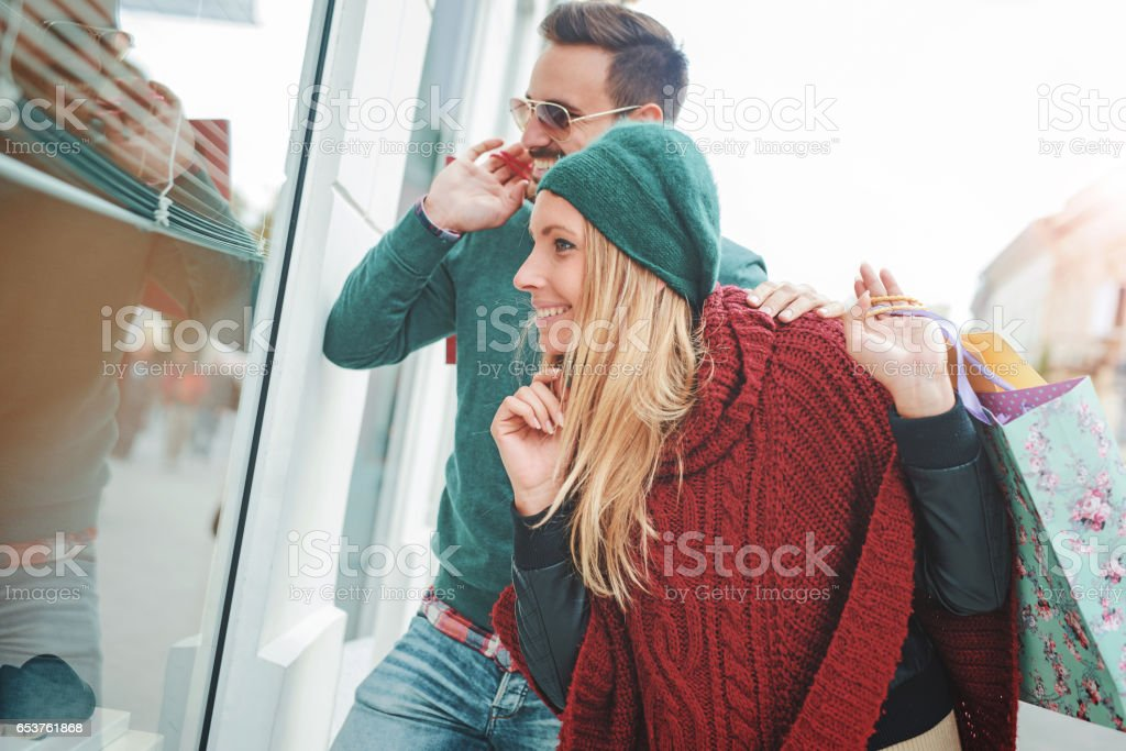 Handsome young couple in shopping. Consumerism, lifestyle concept stock photo