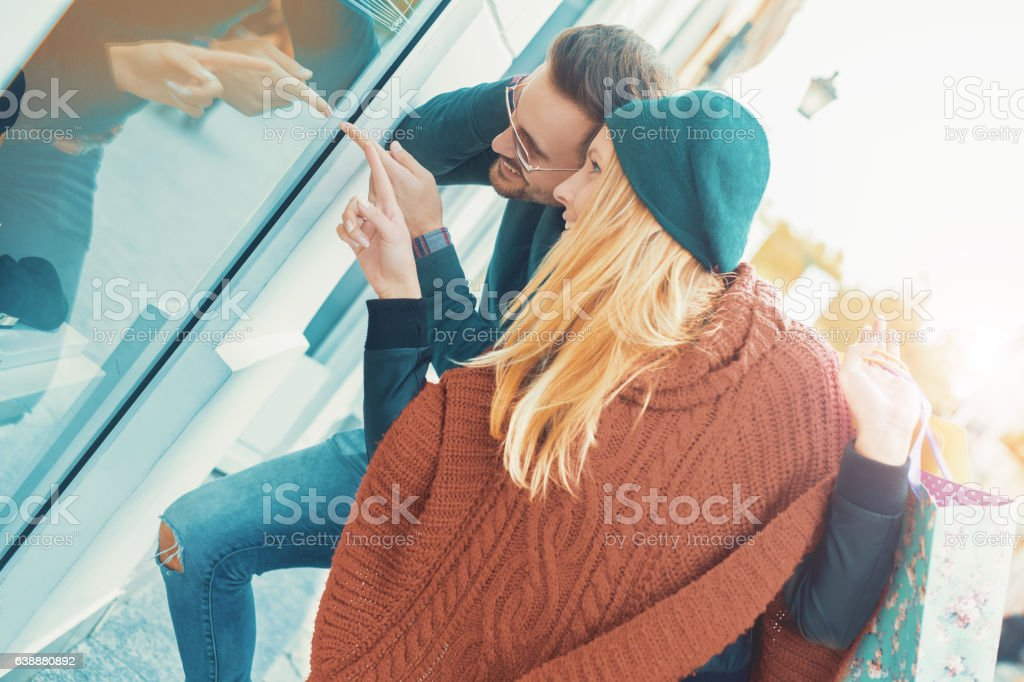 Handsome young couple in shopping. Consumerism, shopping, lifest stock photo