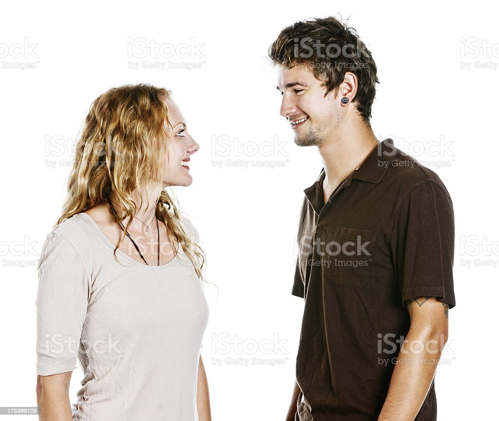 Handsome young couple smile at each other: isolated on white stock photo