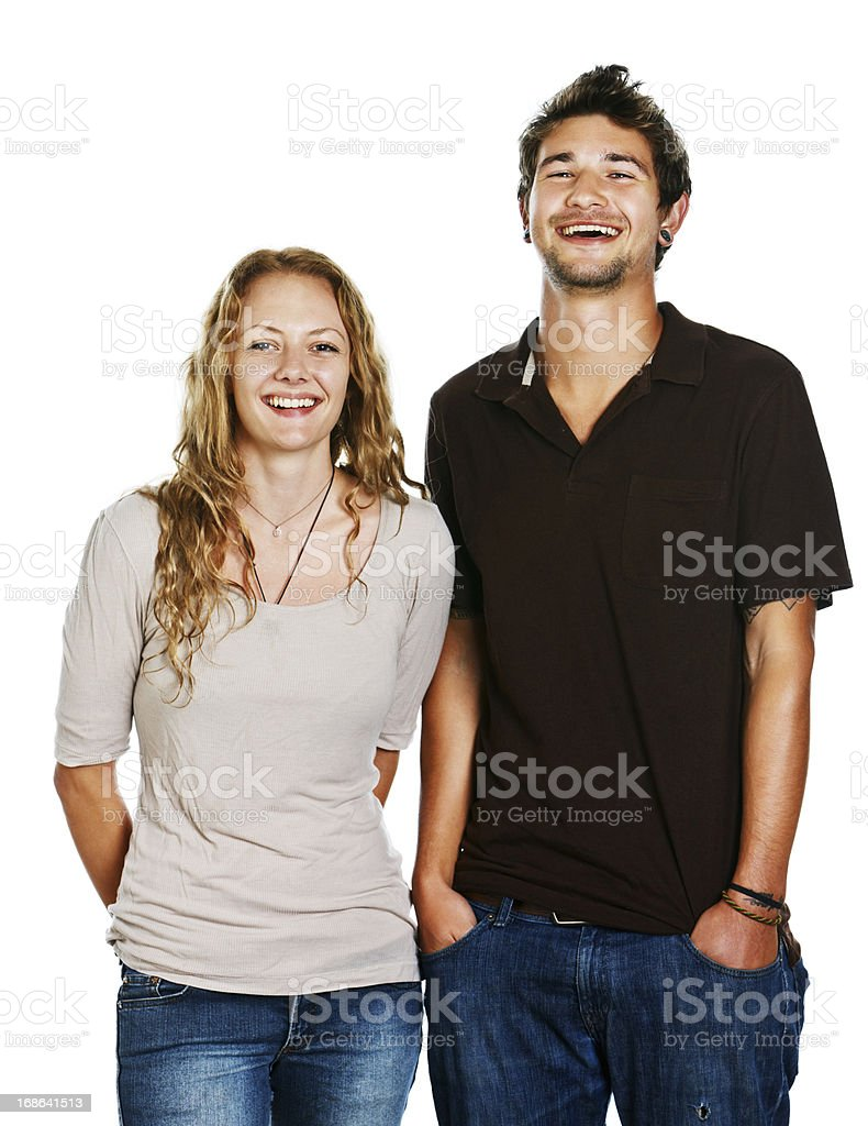 Handsome young couple stand together laughing stock photo