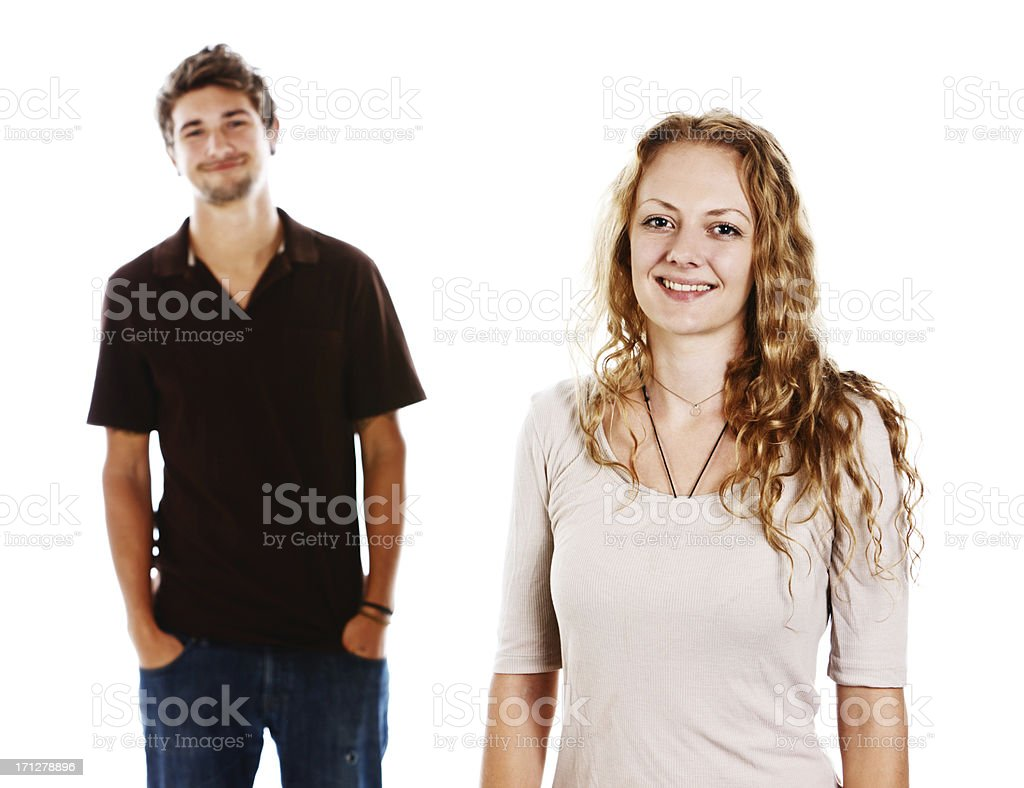 Handsome young couple standing together smiling stock photo