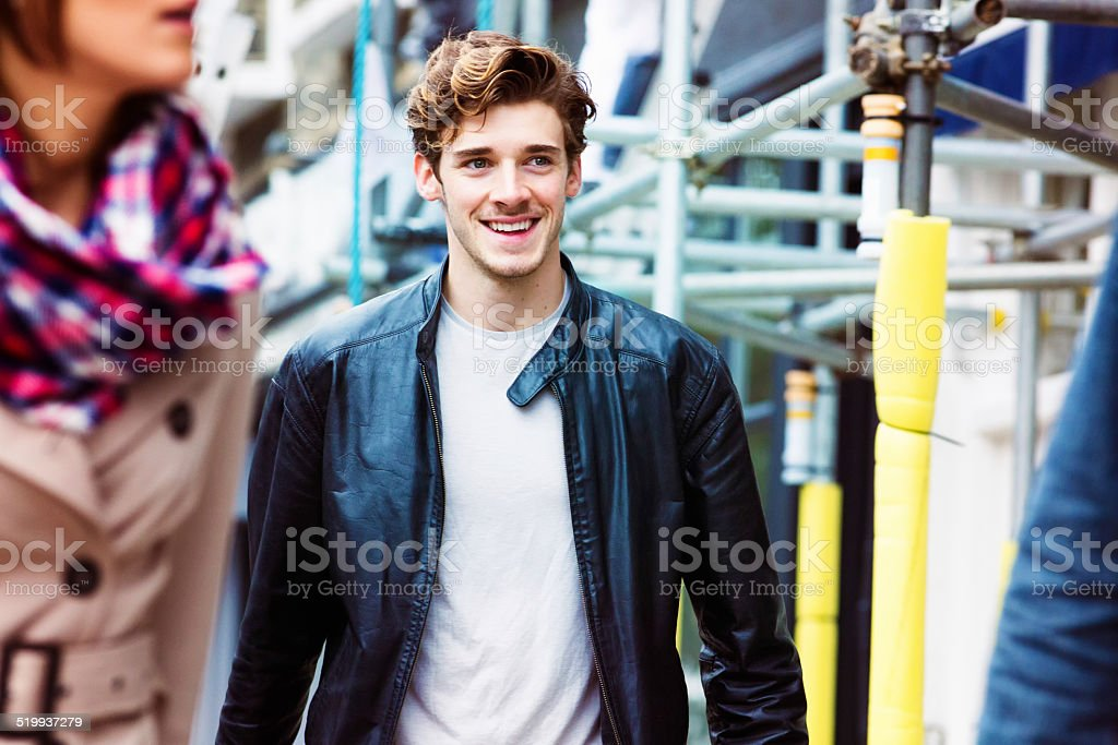 Handsome young English male commuter smiling stock photo
