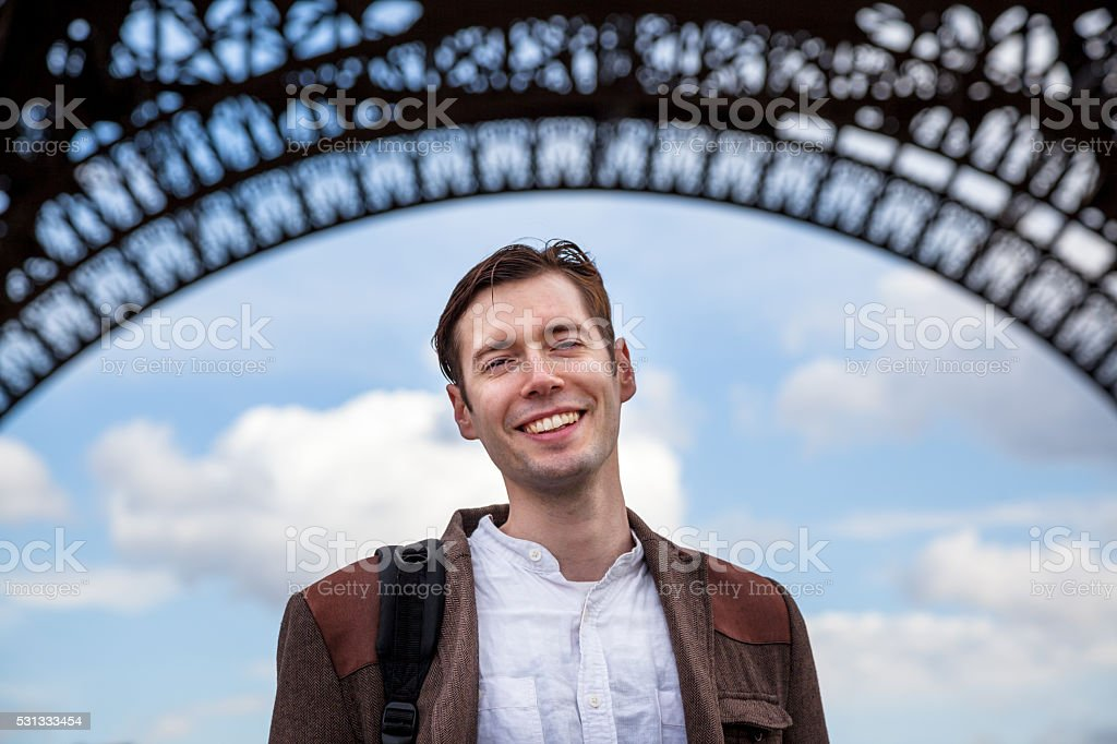 handsome young Frenchman visits the Eiffel Tower stock photo