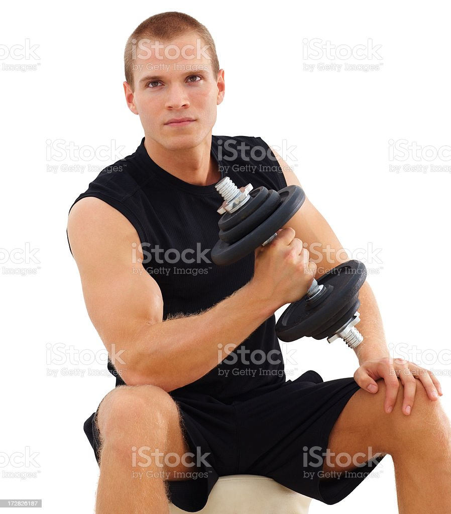 Handsome young guy exercising with a dumbbell stock photo