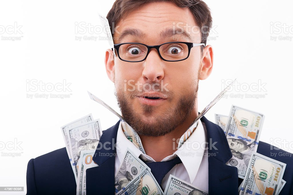 Handsome young guy is crazy about savings stock photo
