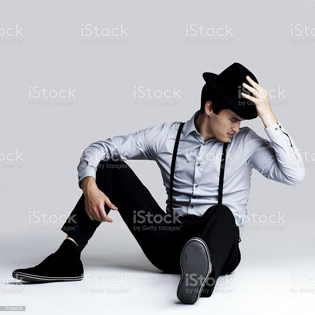 Handsome young guy posing with hat - Copyspace royalty-free stock photo