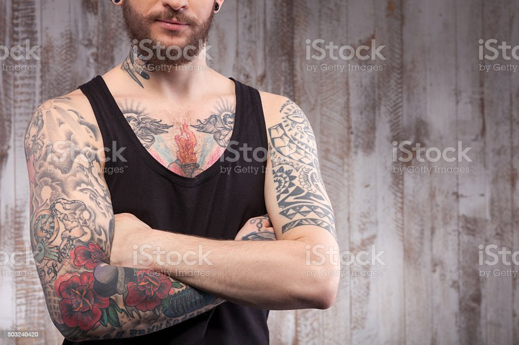 Handsome young guy with tattoos and beard stock photo