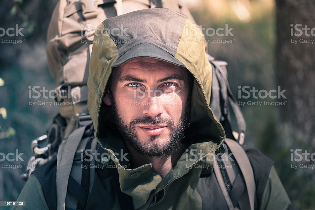 Handsome young hiker portrait stock photo