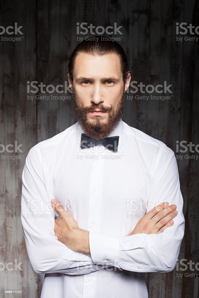 Handsome young hipster guy with big beard stock photo