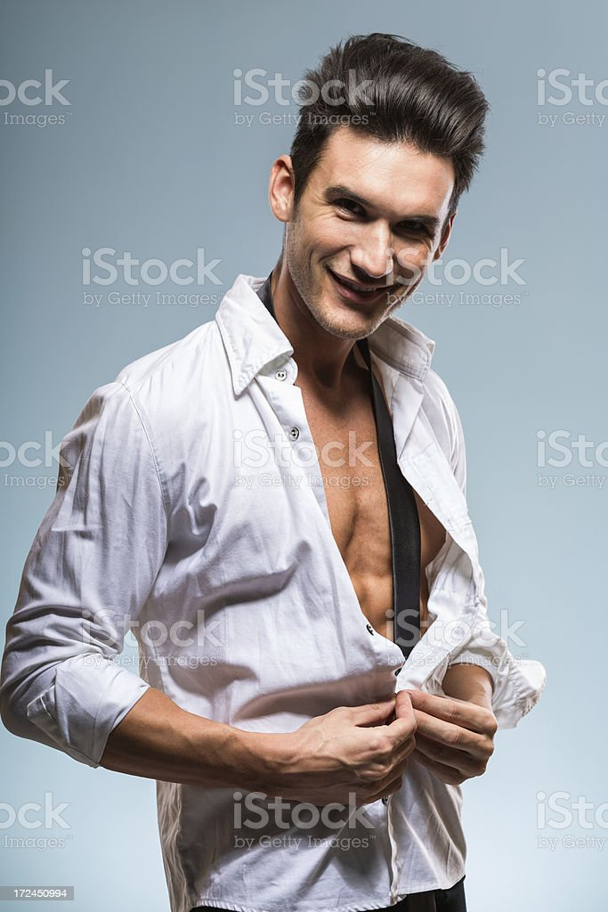 Handsome young man buttoning royalty-free stock photo