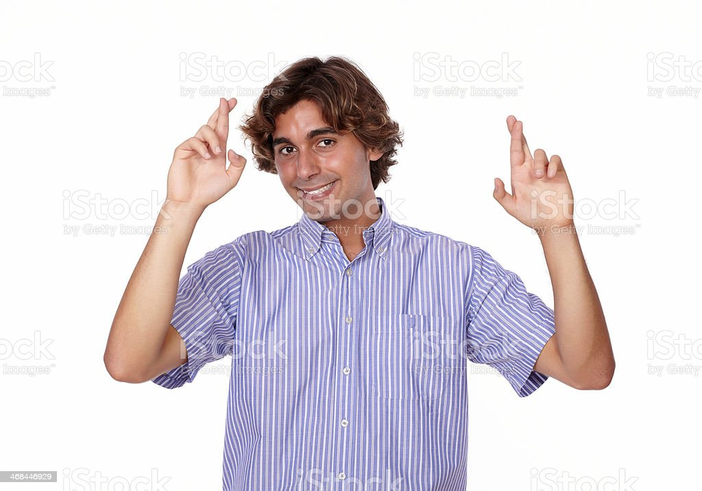 Handsome young man crossing fingers for luck royalty-free stock photo